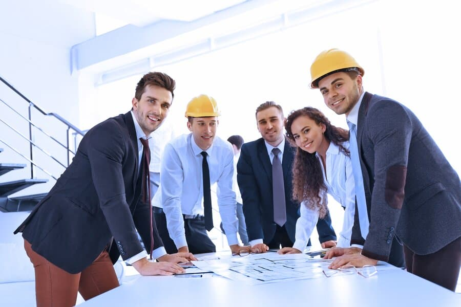 stock-photo-team-of-professional-engineers-working-with-blueprints-422409181-resized (1)